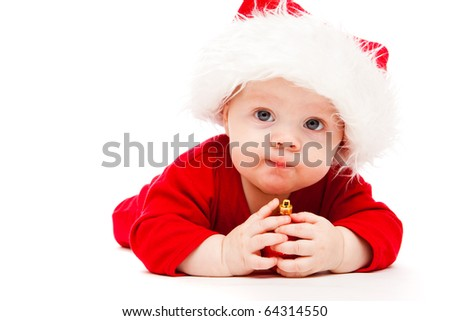 Kid holding red Christmas decoration in hands - stock photo