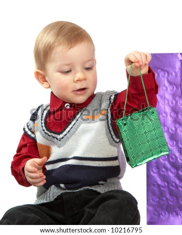 kid holds a green package - stock photo