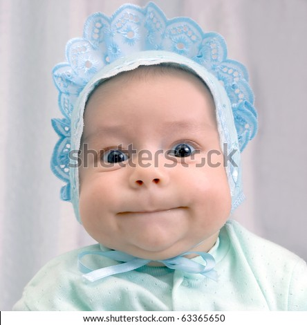 kid in a blue lacy cap - stock photo