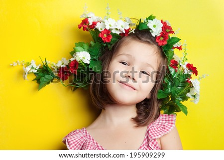 Kid in a flower crown - stock photo