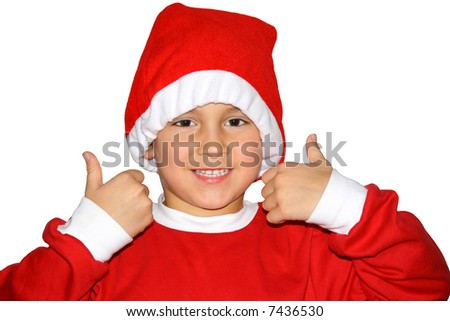 Kid in a santa outfit giving thumb up - stock photo