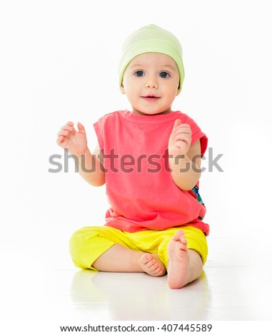 Kid in bright summer clothes. Beautiful happy baby. One, isolated on white.