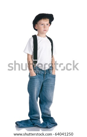 Kid in cap and too long jeans - stock photo