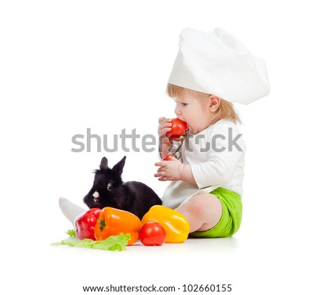 Kid in chef hat with healthy food and rabbit - stock photo