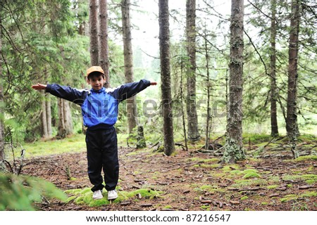Kid in forest - stock photo