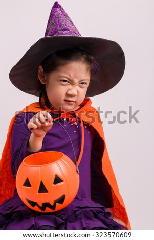 Kid in Halloween Costume on White / Kid in Halloween Costume / Kid in Halloween Costume, Studio Shot - stock photo