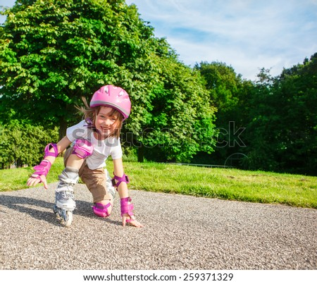 Kid in pink protective sportswear - stock photo