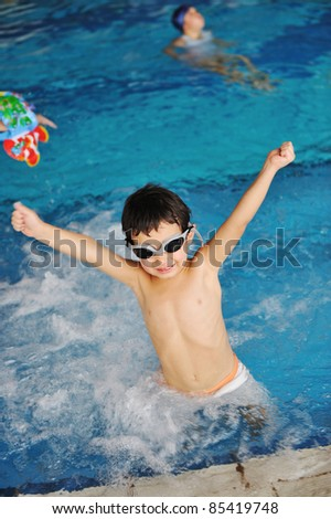 Kid in pool - stock photo