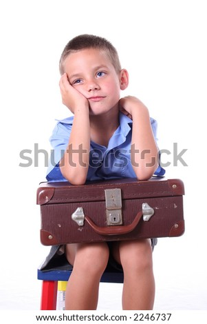 Kid in primary school daydreaming - stock photo