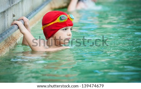 Kid in thermal swimming pool. - stock photo