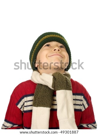 Kid in warm clothes looking up smiling, isolated on white background