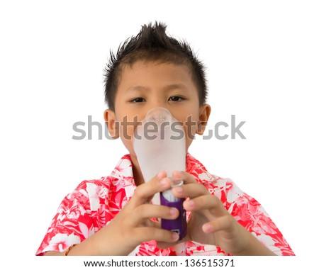 Kid inhaler at nose - stock photo