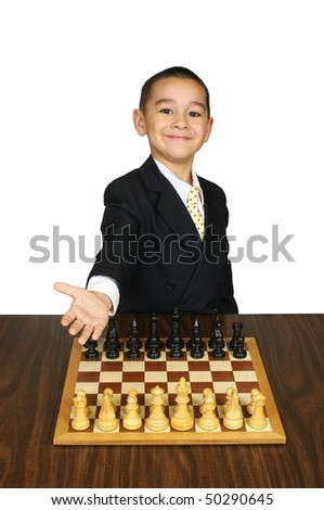 Kid inviting you to play chess, smiling, it's your move - stock photo