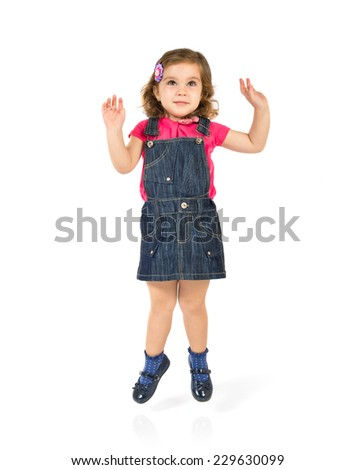 Kid jumping over isolated white background - stock photo