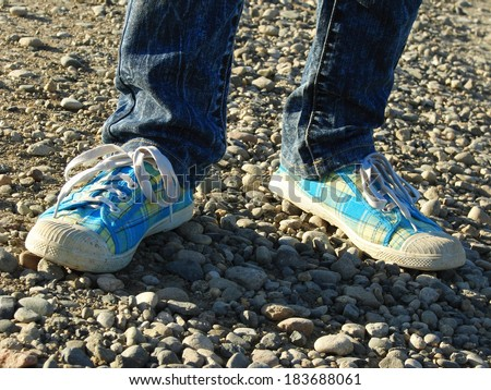 kid legs with gym shoes on stone track.                          - stock photo
