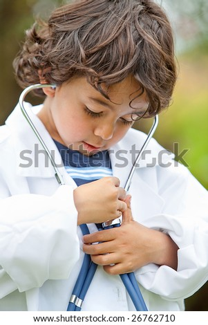 Kid listening to his own heart with a stethoscope