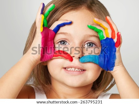 Kid. Little girl and boy hands painted  in colorful paints - stock photo