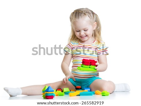 kid little girl playing block toys isolated on white