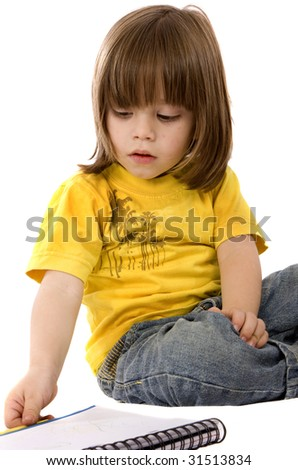 Kid looking at a notebook isolated over white - stock photo