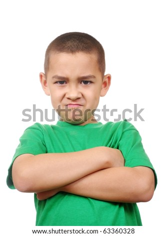 kid  looking down scowling angry, arms crossed - stock photo