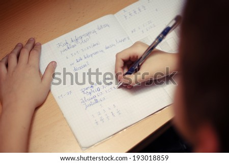Kid making home work for school