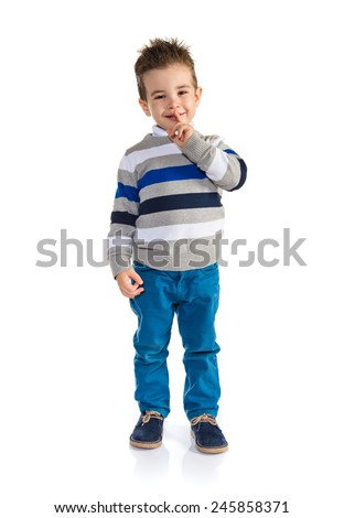 Kid making silence gesture - stock photo