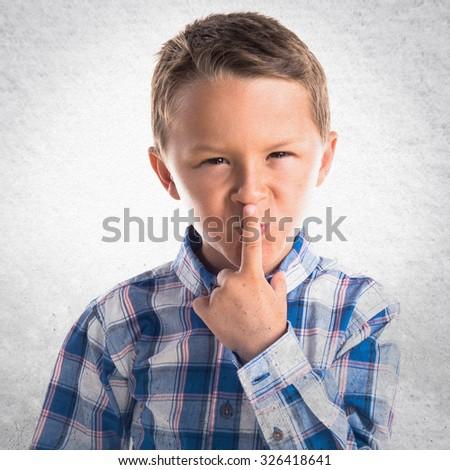 Kid making silence gesture  - stock photo