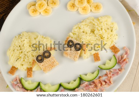 Kid meal with mashed potatoes decorated as a flock of sheep - stock photo