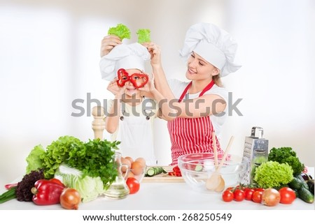 Kid. Mother and kid cooking and having fun in kitchen - stock photo