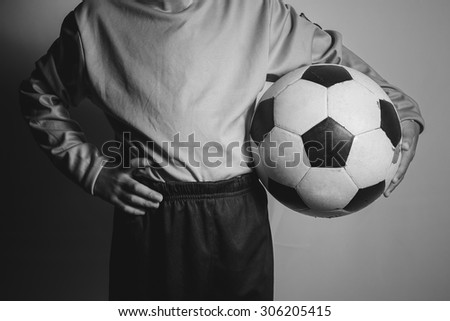 kid of football player - stock photo