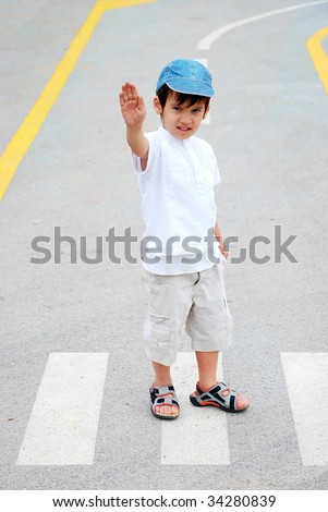 Kid on pedestrian side walk - stock photo
