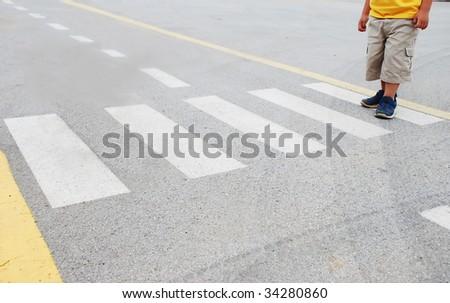 Kid on pedestrian side walk - stock photo