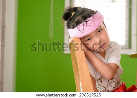 Kid on sick mood with cold pack - stock photo