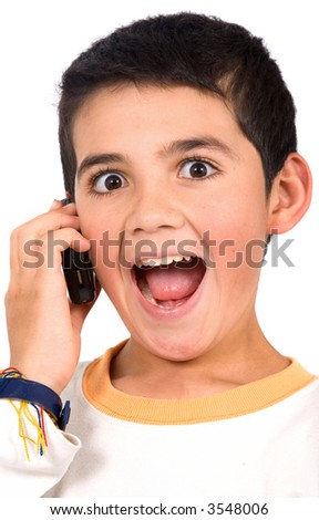 Kid on the phone looking surprised to hear the good news - isolated over a white background - stock photo