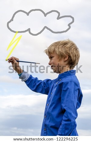 kid painting lightning - stock photo