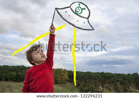 kid painting ufo - stock photo
