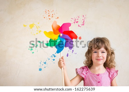 Kid painting wall with multicolor palette. Renovation concept - stock photo