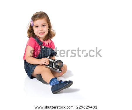 Kid photographing over white background - stock photo