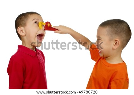 Kid pinching another boy's nose with toy wrench, isolated on white background