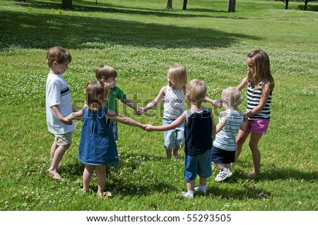 kid play outdoors in the bright sun just having fun - stock photo