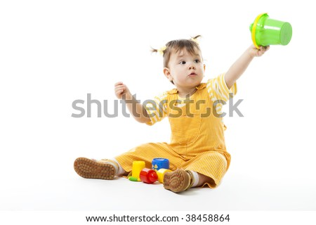 Kid play sit and with toys, holding pail,isolated on white - stock photo