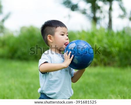 Kid play soccer ball at outdoor - stock photo