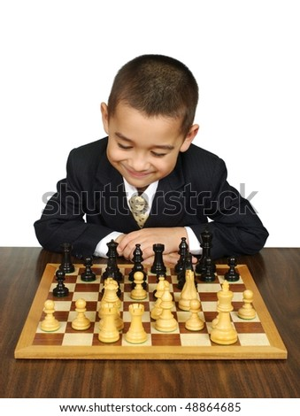 Kid playing chess, smiling, isolated on white background - stock photo