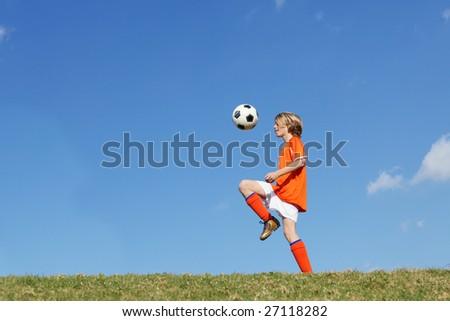 kid playing football - stock photo