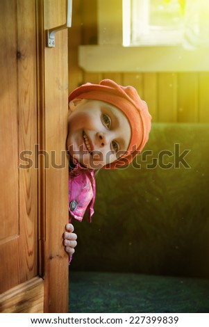 Kid playing hide and seek. - stock photo