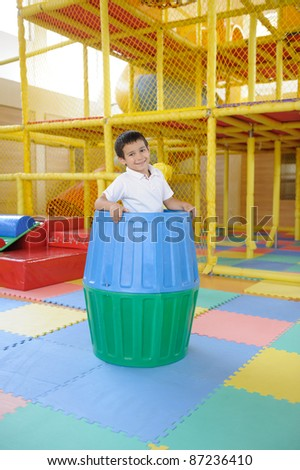 Kid playing, playground in kindergarten - stock photo