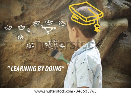 kid playing with brush and stone background , any idea ,new idea with Imagination and dreams concept , concept for learning by doing, education concept - stock photo