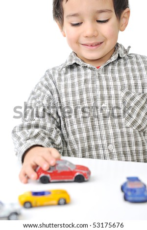 Kid playing with cars - stock photo
