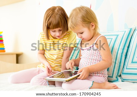 kid playing with digital tablet
