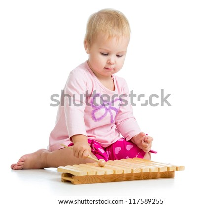 kid playing with musical toy - stock photo